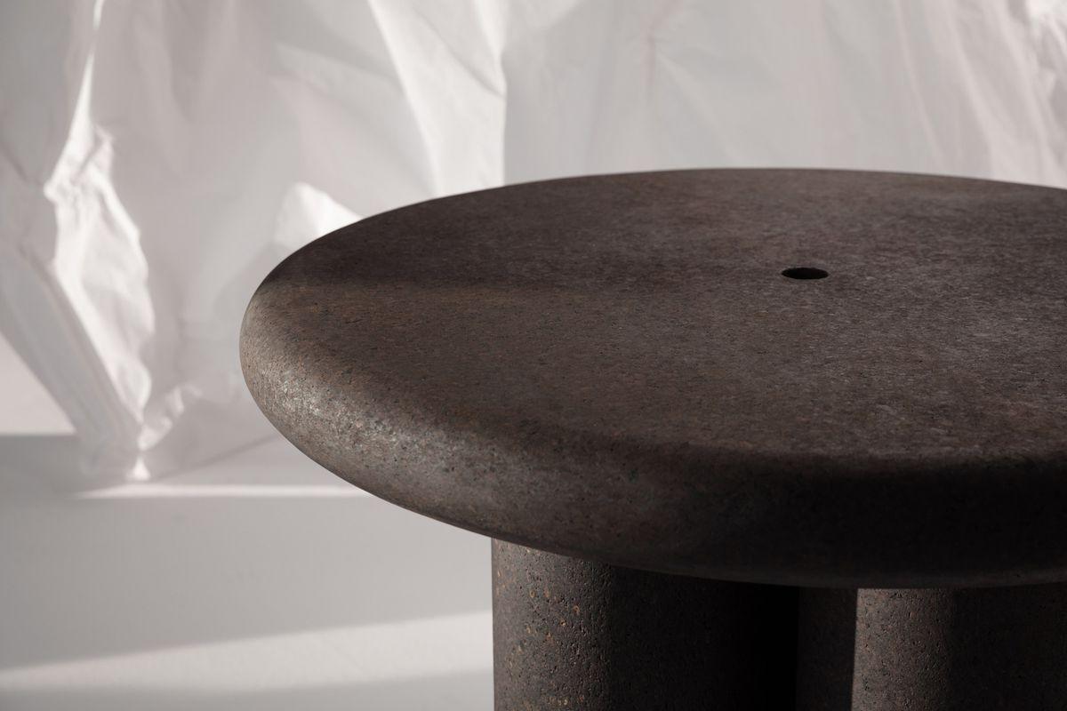 Close up of dark brown round cork table.