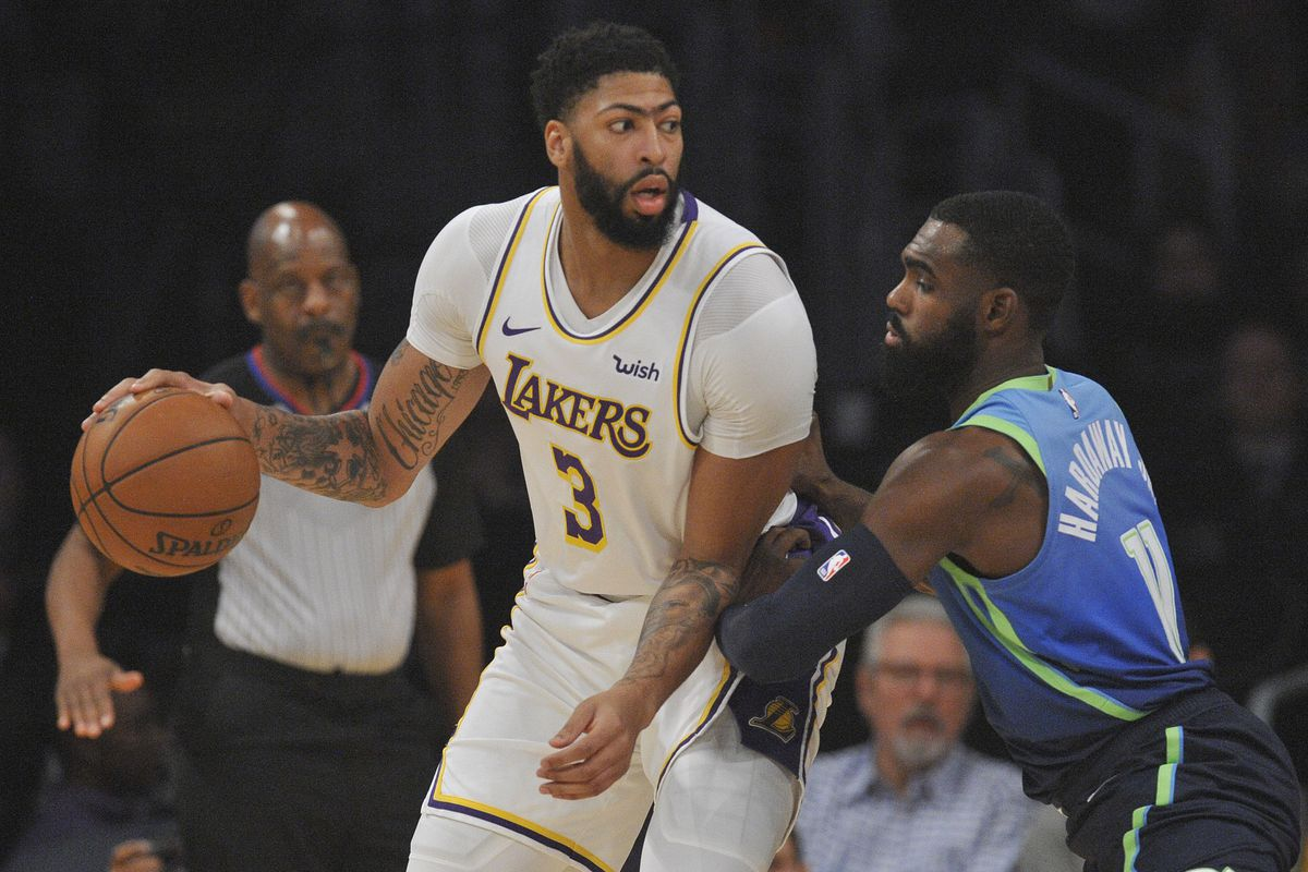 Los Angeles Lakers forward Anthony Davis controls the ball against the defense of Dallas Mavericks guard Tim Hardaway Jr. during the first half at Staples Center.