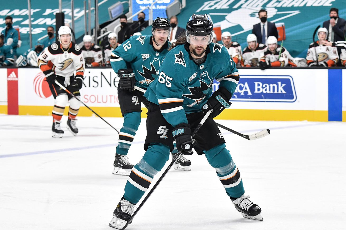 Erik Karlsson #65 of the San Jose Sharks skates ahead with the puck against the Anaheim Ducks at SAP Center on April 12, 2021 in San Jose, California.
