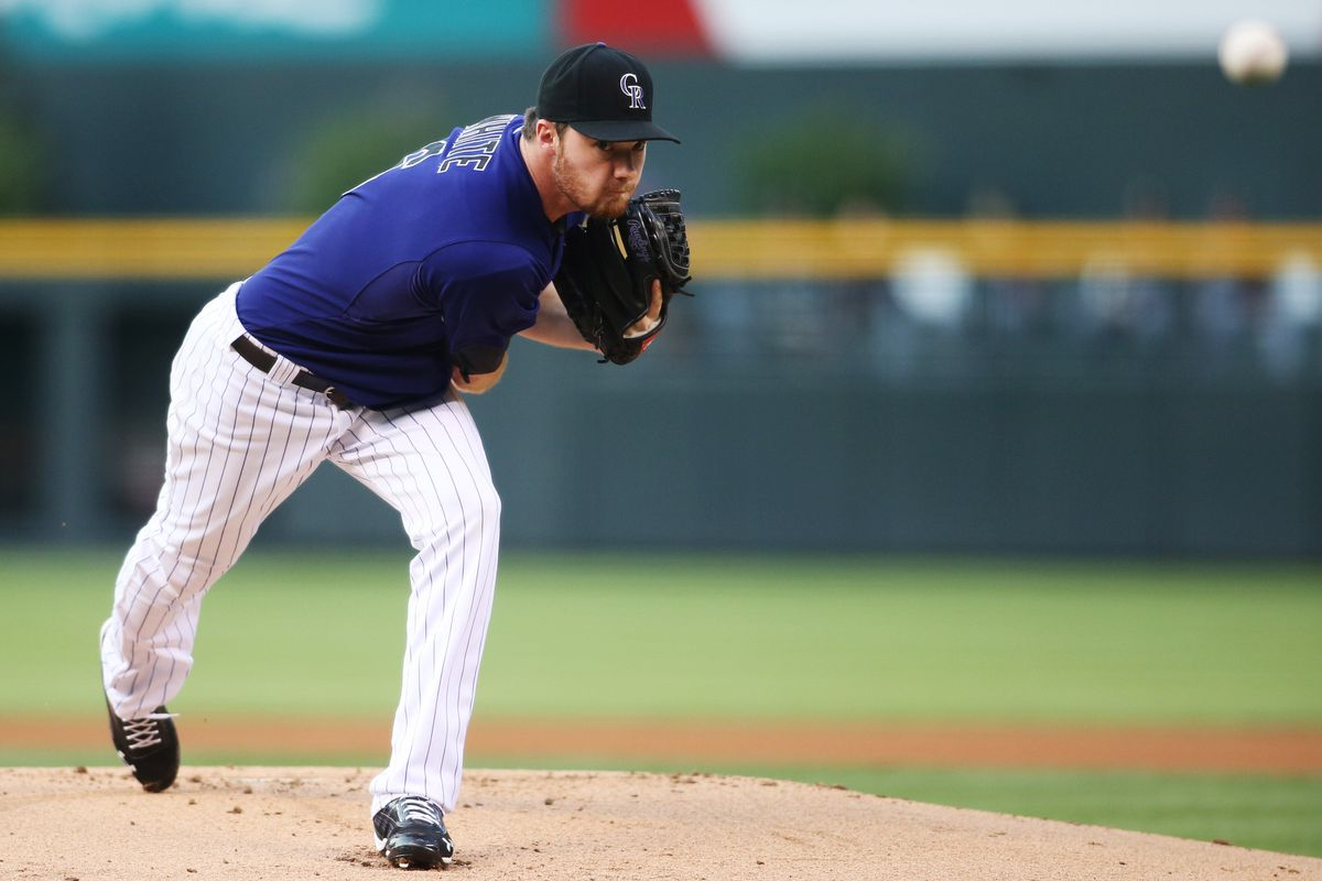 August 16, 2012; Denver, CO, USA; Colorado Rockies pitcher Alex White (6) delivers a pitch during the first inning against the Miami Marlins at Coors Field. Mandatory Credit: Chris Humphreys-US PRESSWIRE