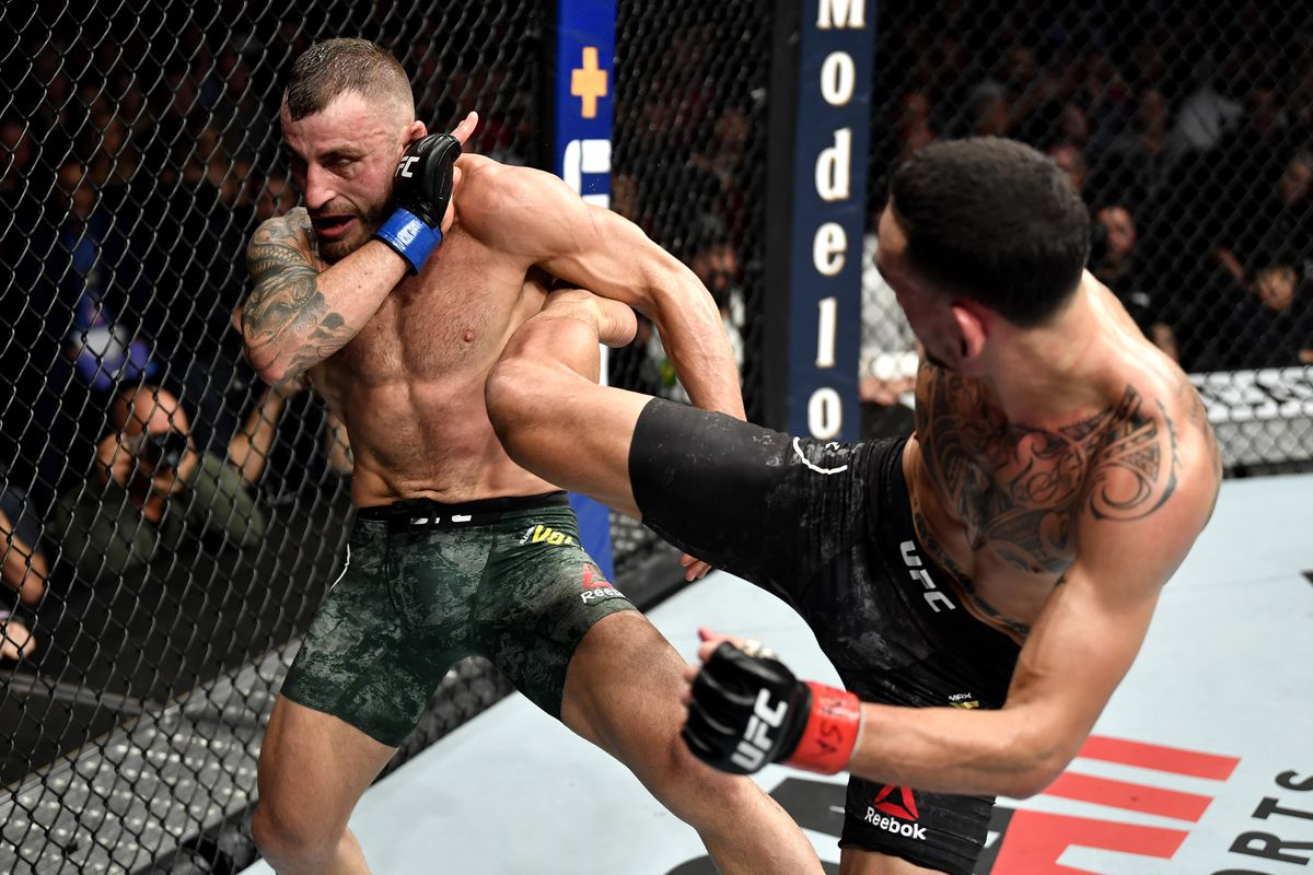 Max Holloway kicks Alexander Volkanovski of Australia in their UFC featherweight championship bout during the UFC 245 event at T-Mobile Arena on December 14, 2019 in Las Vegas, Nevada.