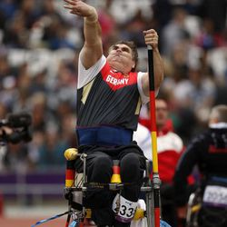 Germany's Ulrich Iser throws in the men's shot put F54/55/56 category during the athletics competition at the 2012 Paralympics, Saturday, Sept. 1, 2012, in London.