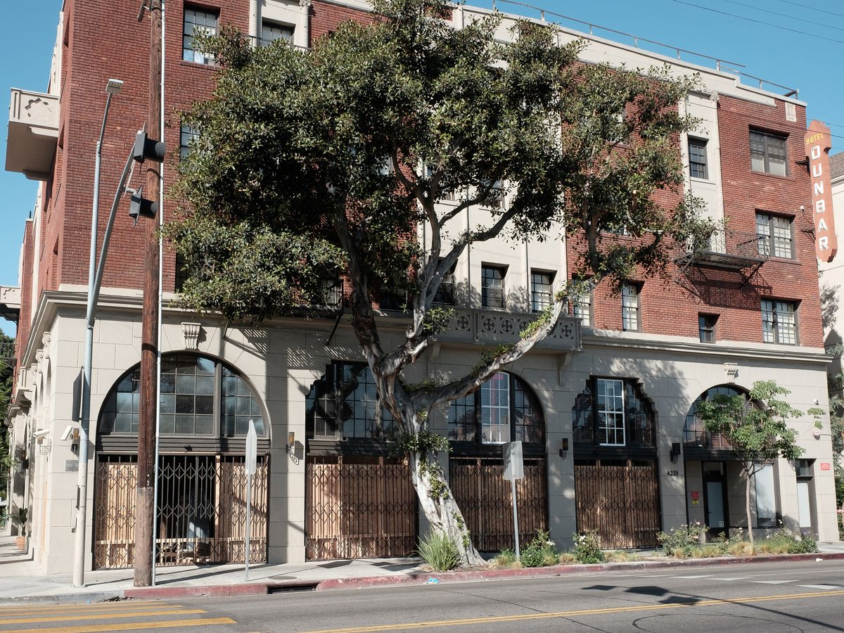 The exterior of the Dunbar hotel in Los Angeles. The facade is red brick.