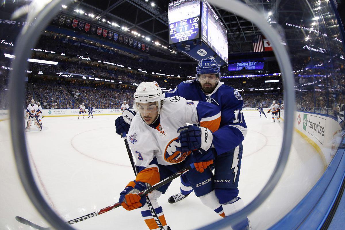 New York Islanders defenseman Travis Hamonic (3) and Tampa Bay Lightning center Alex Killorn (17)