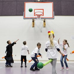 """Professor Beck's third graders play a game of Quidditch inside of Blackridge Elementary gym Friday, Feb. 5, 2016 in Herriman. The students, as well as the entire third grade class, have been recreating """"Hogwarts School of Witchcraft and Wizadry"""" right inside of their classroom for a week of curriculum based entirely around the popular Harry Potter fantasy books."""