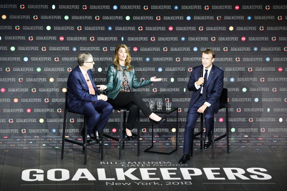Bill and Melinda Gates on stage with Emmanuel Macron.