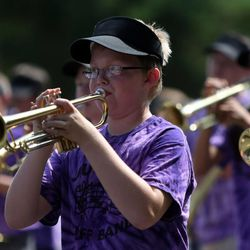 Members of the Junior Buff Band march in the Days of '47 Youth Parade in Salt Lake City on Saturday, July 20, 2013.
