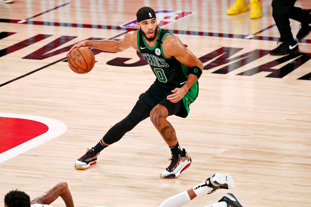 Boston Celtics forward Jayson Tatum controls the ball against the Miami Heat during the fourth quarter in game two of the Eastern Conference Finals of the 2020 NBA Playoffs at ESPN Wide World of Sports Complex.