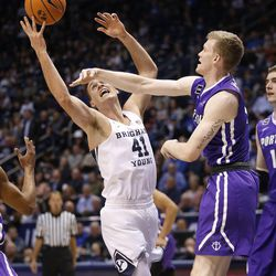 Brigham Young Cougars forward Luke Worthington (41) competes with Portland Pilots guard Josh McSwiggan (11) in Provo on Thursday, Dec. 28, 2017.