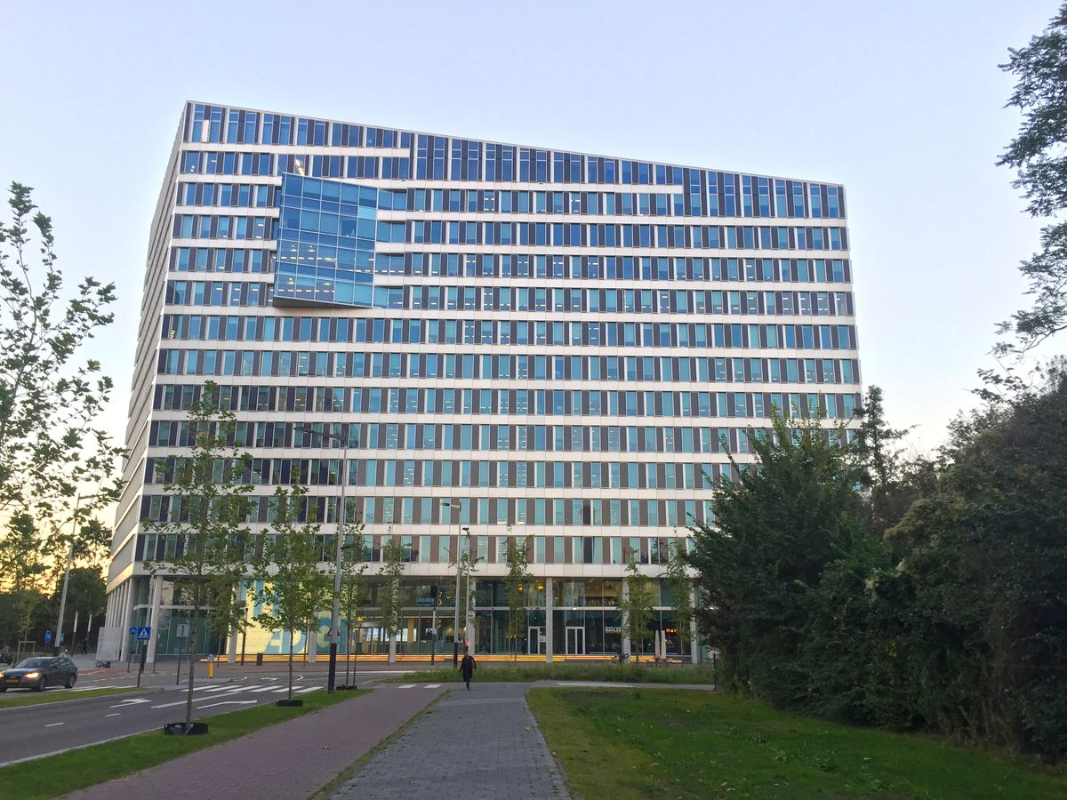 A large office building with a sloped roof