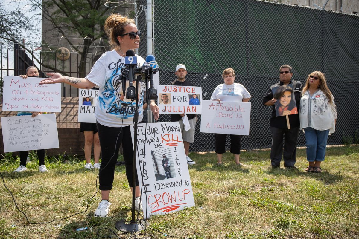 Nikki Swoboda, whose son was shot and killed in February, speaks at a rally demanding judges hold defendants in violent crime cases without bail on Saturday near the Leighton Criminal Courthouse.