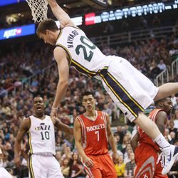 Utah Jazz's small forward Gordon Hayward (20) hangs on the rim after a dunk as the Jazz and the Rockets play Saturday, Nov. 2, 2013 in EnergySolutions arena.
