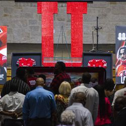 Friends and family pay their respects to Aaron Lowe during a funeral service at Family Cathedral of Praise on Monday, Oct. 11, 2021, in Mesquite, Texas. Lowe, a student and football player at the University of Utah, was was shot and killed on Sept. 26 at a postgame party.