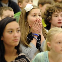 Addie Goettig reacts to seeing her father, Air Force Tech Sgt. Edward Goettig, walk down the stage at Fox Hollow Elementary School on Thursday, March 6, 2014. Goettig had been deployed to Afghanistan since Aug. 27, 2013.