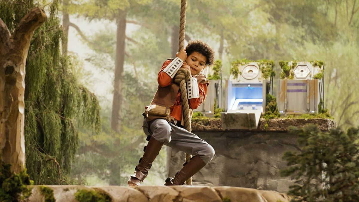 kid swings from forest cliff to forest cliff in Jedi Temple Challenge and it looks awesome