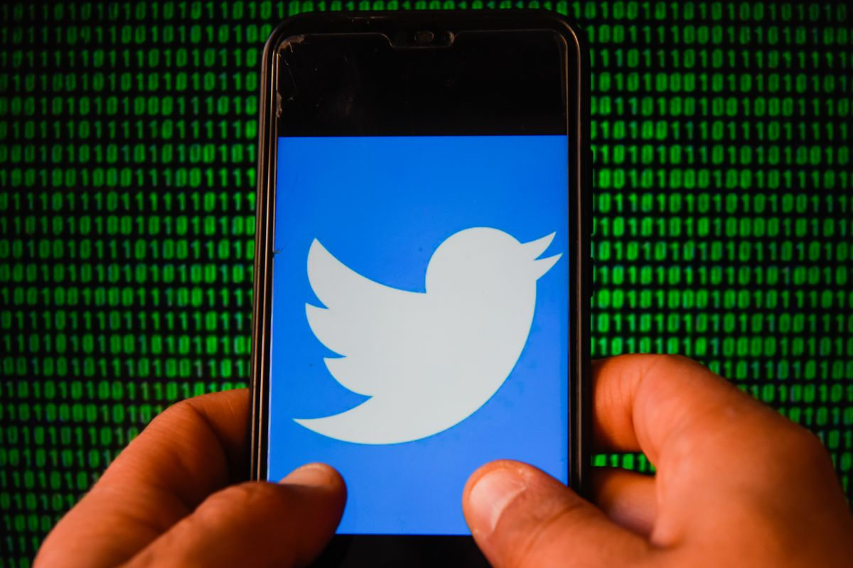 In this photo illustration a Twitter logo is seen displayed...