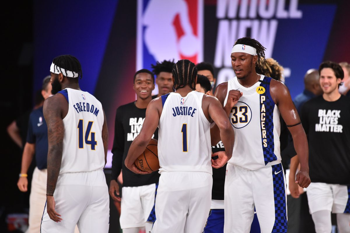 T.J. Warren of the Indiana Pacers high-fives his teammates after a game against the Philadelphia 76ers on August 1, 2020 at Visa Athletic Center at ESPN Wide World of Sports in Orlando, Florida.