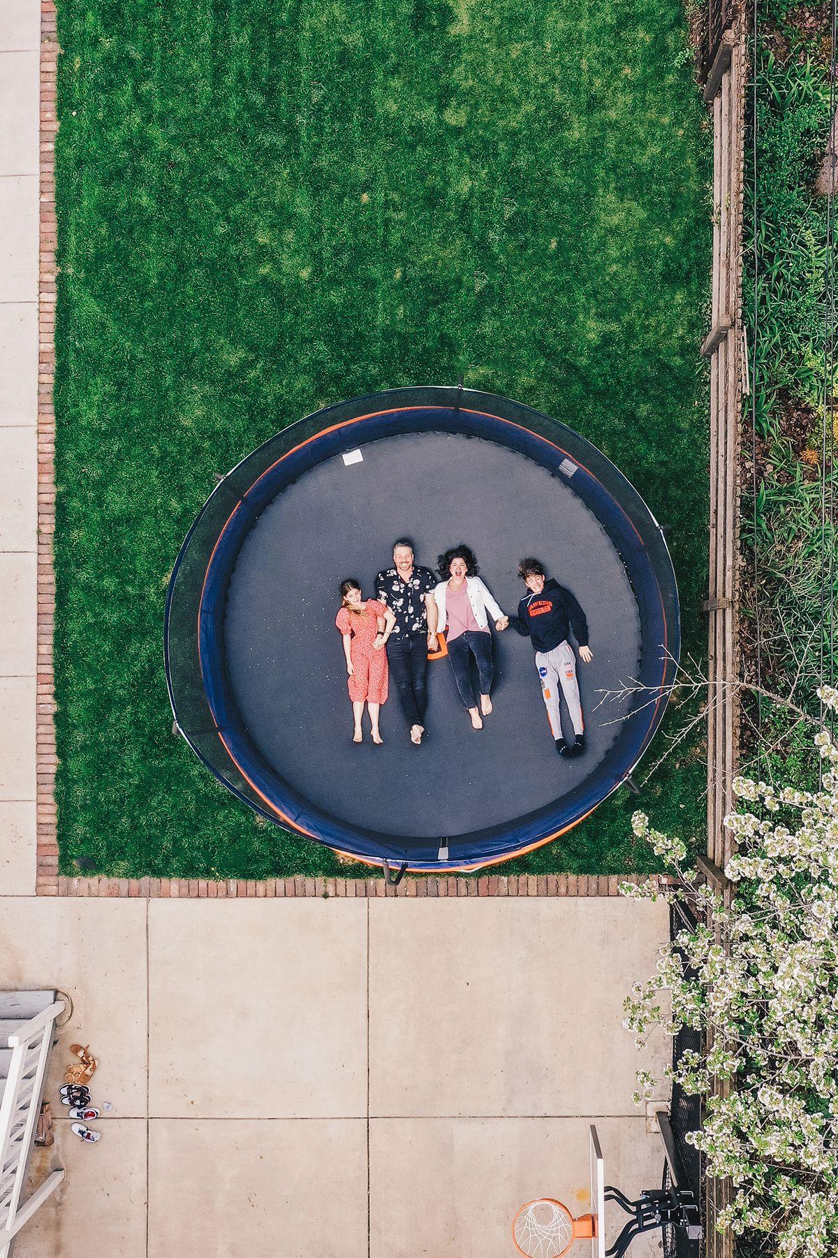 Gigi, Jarrett, Jeanne and Elijah Stevens on their trampoline in their West Loop backyard.