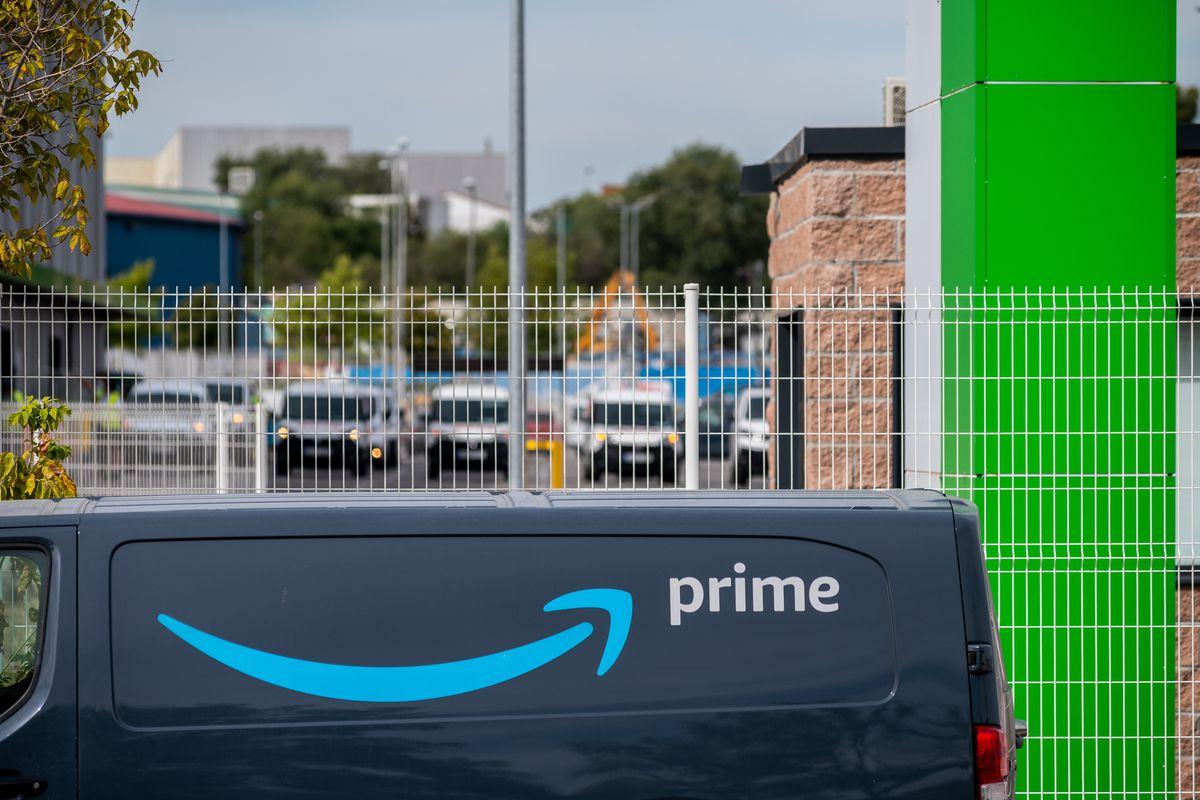 Amazon van with prime logo in a logistic centre. Amazon has...