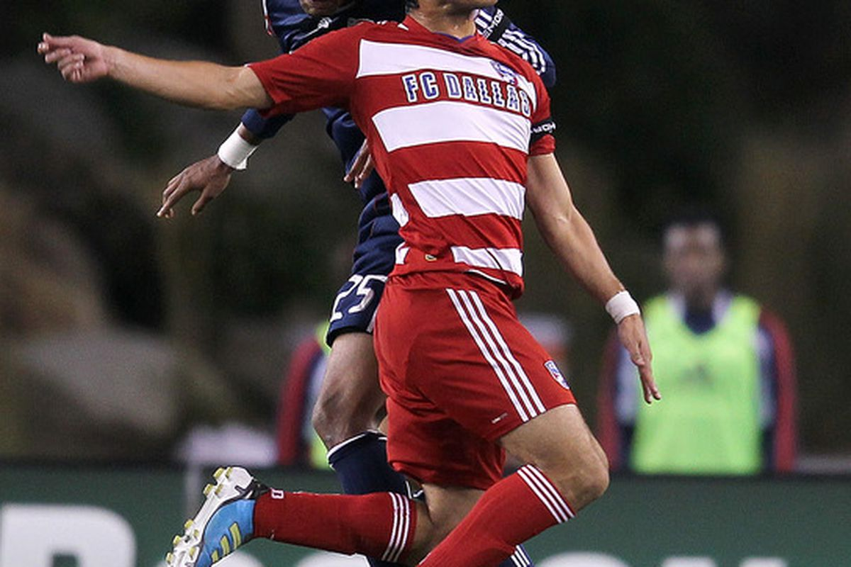 FOXBORO, MA - SEPTEMBER 10:  Darrius Barnes #25 of the New England Revolution battles Milton Rodriguez #7 of the FC Dallas at Gillette Stadium on September 10, 2011 in Foxboro, Massachusetts. (Photo by Jim Rogash/Getty Images)