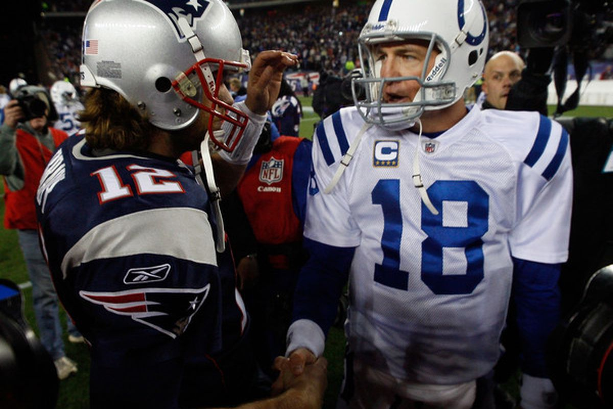 FOXBORO MA - NOVERMBER 21:  Tom Brady #12 of the New England Patriots shakes hands with Peyton Manning #18 of the Indianapolis Colts after their game at Gillette Stadium on November 21 2010 in Foxboro Massachusetts. (Photo by Jim Rogash/Getty Images)