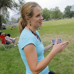 Merrilee Blackham expresses her feelings about a proposed ban on swearing at city parks in Odgen as she watches her son's little league football practice at Monroe Park Wednesday, Aug. 8, 2012. Ogden is looking to ban swearing in city parks.