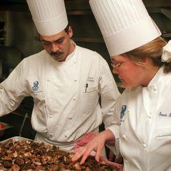Chef Sarah Stegner looking over a tray of newly delivered morel mushrooms.  Ellen Domke  Sun-Times