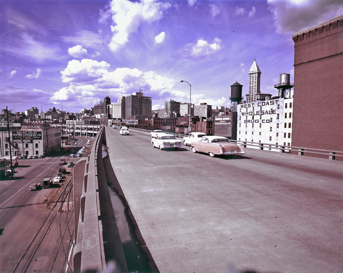An old photo showing cars driving on a viaduct in Seattle.