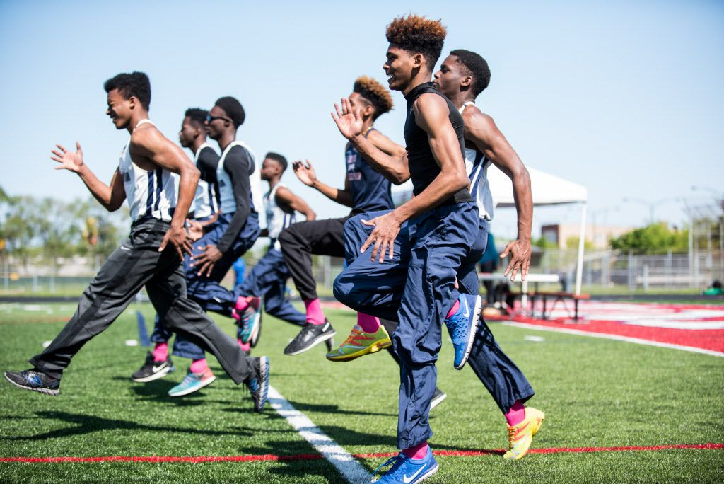 The Johnson College Prep boys track team honors teammate De'Kayla Dansberry. | Max Herman/For the Sun-Times