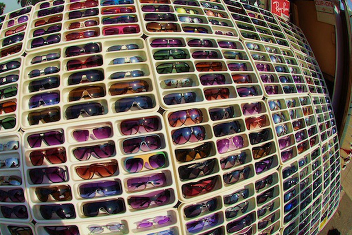 """The sun is out, time to pick up some cheap shades on the Venice Boardwalk. Image via <a href=""""http://www.flickr.com/photos/reneerk/4221646474/in/pool-708420@N23"""">RackedLA Flickr Pool</a>."""