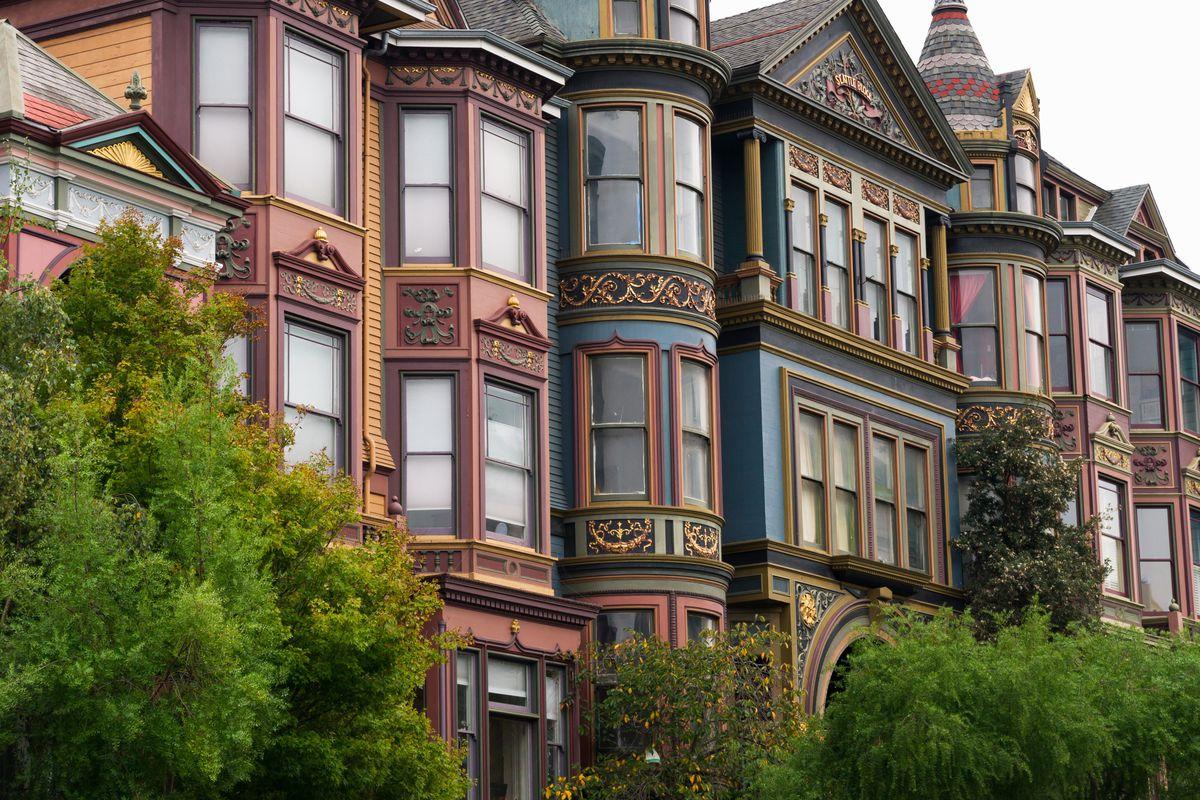 Rows of Victorian facades with bay windows.