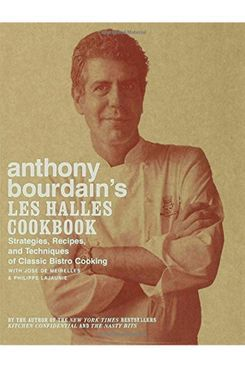 A cookbook titled Les Halles Cookbook with a photo of Anthony Bourdain