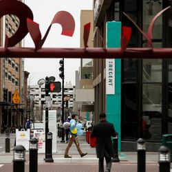 People walk in downtown Salt Lake City on Friday, March 13, 2020.