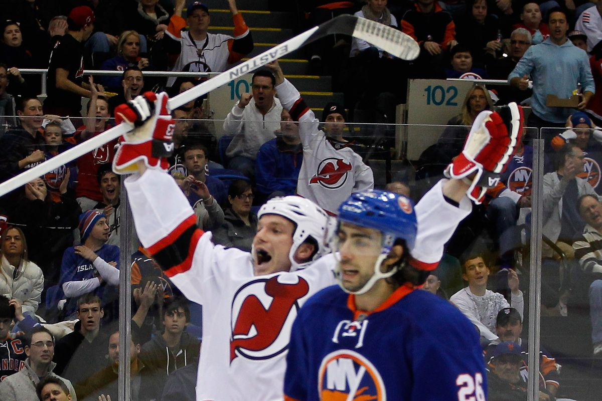 Foreground: An unhappy Matt Moulson.  Background: A celebrating David Clarkson, who just scored.