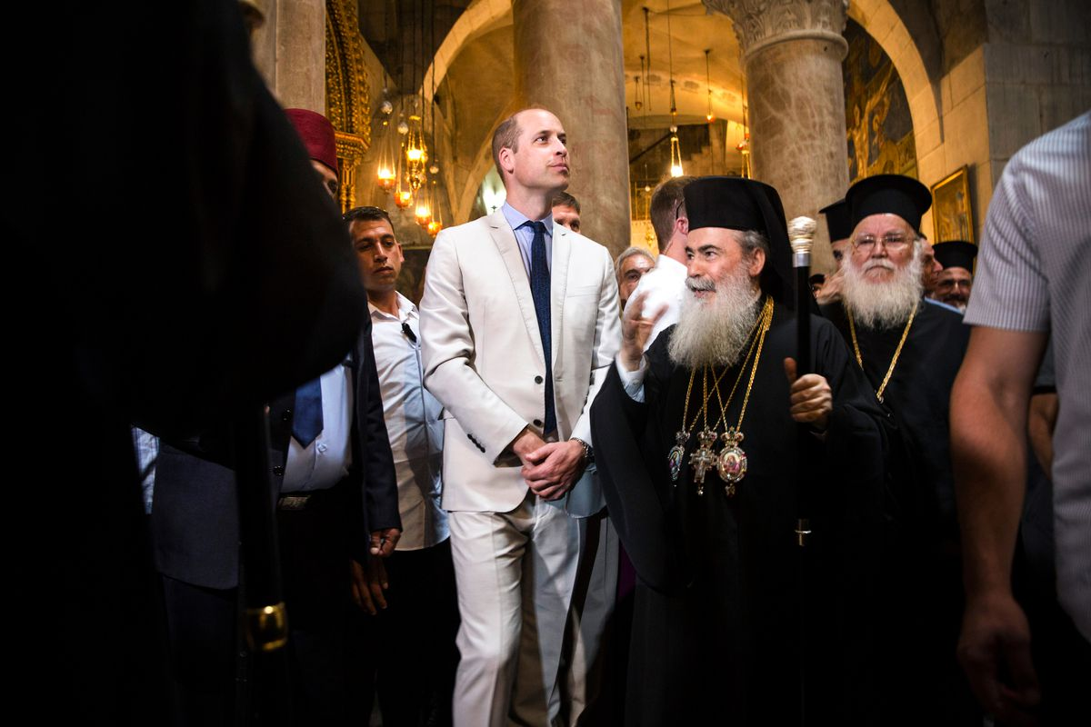 June 28: Britain's Prince William walks alongside Greek Orthodox Patriarch of Jerusalem Theophilos III as he visits the Church of the Holy Sepulchre in Jerusalem's Old City. The Duke of Cambridge is the first member of the royal family to make an official