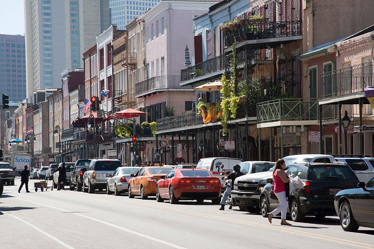 Cars sit in bumper to bumper traffic in the French Quarter