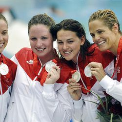 The U.S. women's 4-by-100-meter freestyle relay swimming team won the silver medal at the Beijing Games. LDS athlete Lacey Nymeyer was part of the team, which is, from left, Natalie Coughlin, Kara Lynn Joyce, Nymeyer and Dara Torres. Nymeyer also was an individual competitor in the 100-meter freestyle event.  Ryan Millar of the United States celebrates victory in the gold medal volleyball match.