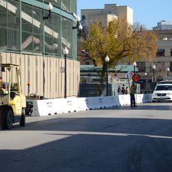 11:00 a.m. Concrete barricades being positioned along Addison Street -