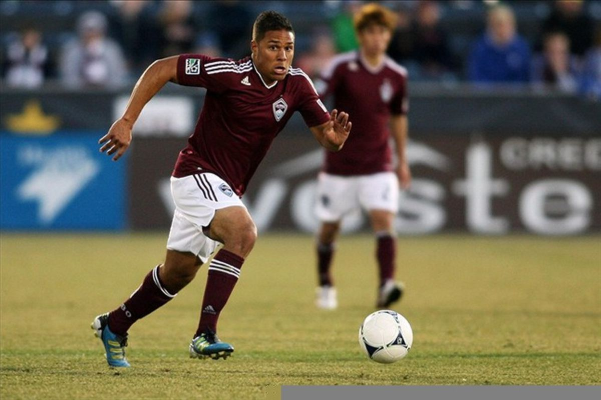 March 10, 2012; Denver, CO, USA; Colorado Rapids forward Quincy Amarikwa (12) controls the ball during the second half against the Columbus Crew at the Dick's Sporting Goods Park.  Mandatory Credit: Chris Humphreys-US PRESSWIRE