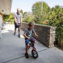 Jon Larsen plays with son George at their home in Millcreek on Wednesday, Sept. 16, 2020.