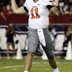 Oklahoma State quarterback Wes Lunt (11) throws against Arizona during the first half of an NCAA college football game at Arizona Stadium in Tucson, Ariz., Saturday, Sept. 8, 2012.