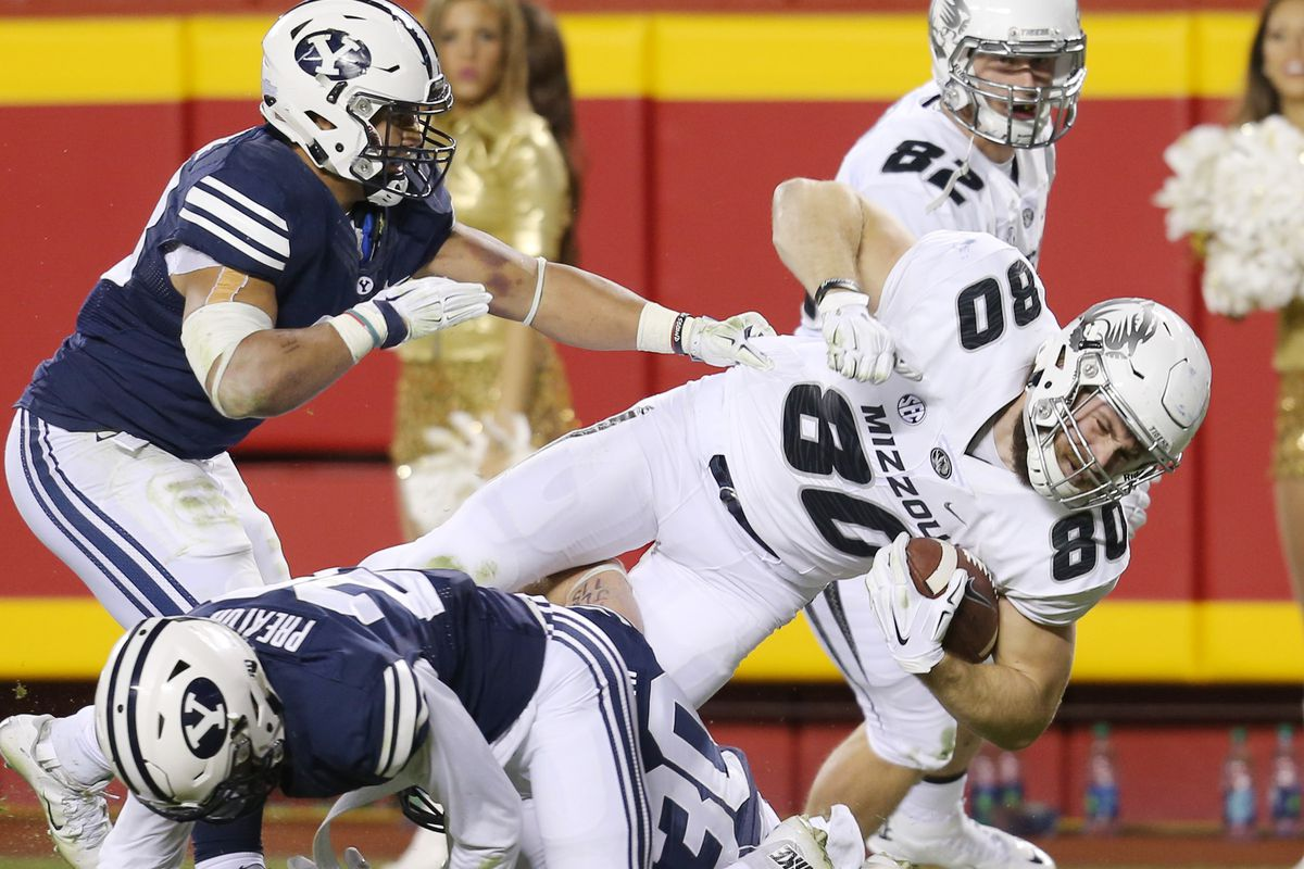 Members of the BYU defense try to bring down Missouri Tigers tight end Sean Culkin (80) before he can score as BYU and Missouri play at Arrowhead Stadium in Kansas City, Missouri, Saturday, Nov. 14, 2015. Missouri won 20-16. BYU and Missouri are scheduled to meet again in 2035 after their 2020 game was canceled due to COVID-19