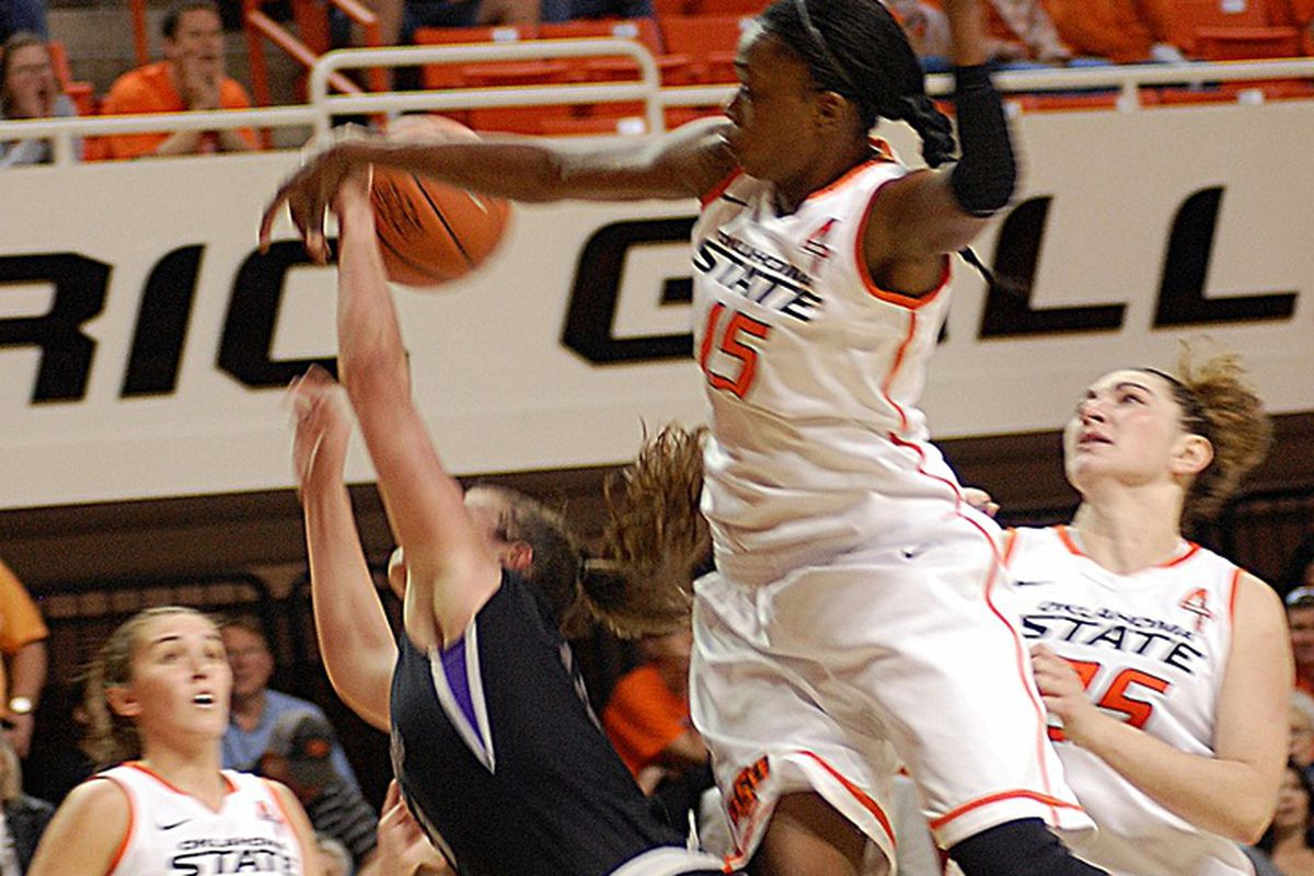 OSU's Toni Young flies in to defend Central Arkansas center Courtney Duever. Young finished with a season-high 22 points en route to becoming the 19th Cowgirl in OSU history to reach 1,000 points.