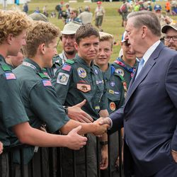 Elder Jeffrey R. Holland of the LDS Church's Quorum of the Twelve Apostles greets 2017 National Jamboree participants prior to a morning sacrament meeting service Sunday, July 23, 2017, at Summit Bechtel Reserve near Glen Jean, West Virginia.