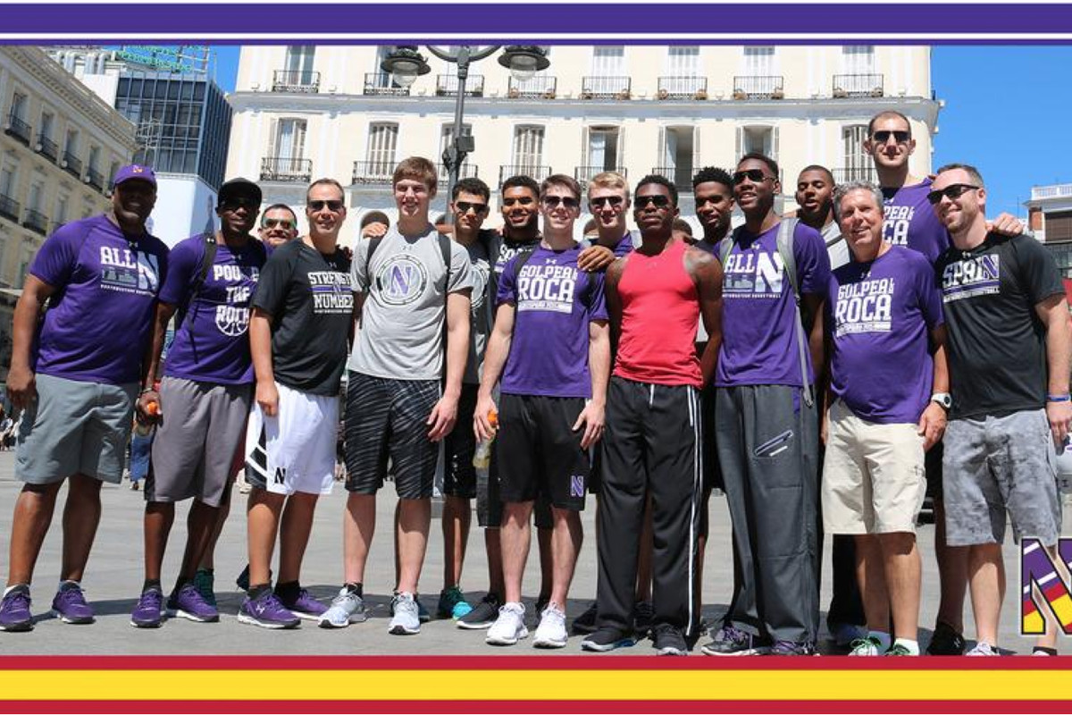 The Wildcats take a team picture just hours after arriving in Spain.