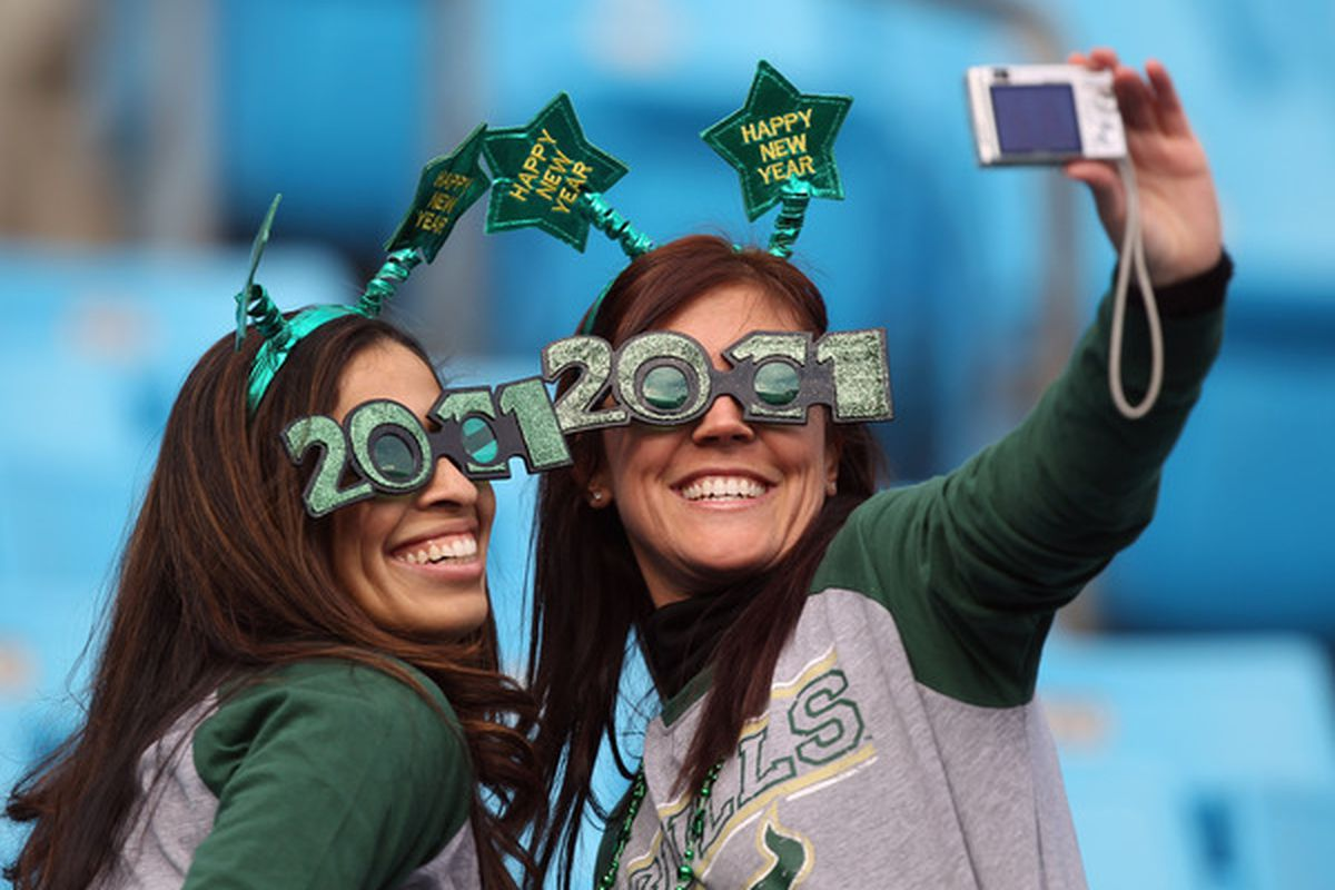 CHARLOTTE NC - DECEMBER 31:  Fans of the USF Bulls take a picture in the stands during their game against the Clemson Tigers at Bank of America Stadium on December 31 2010 in Charlotte North Carolina.  (Photo by Streeter Lecka/Getty Images)