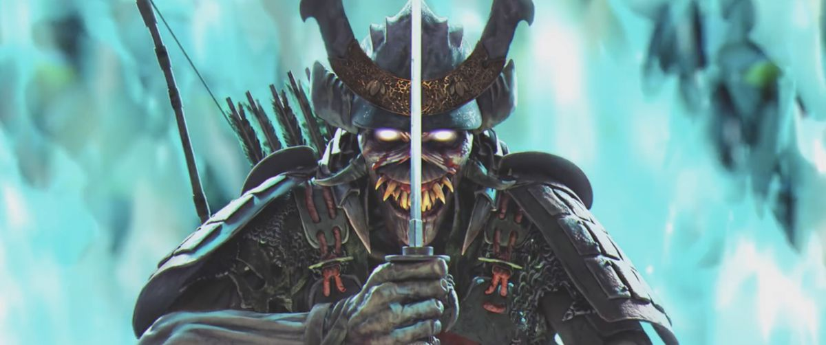 Samurai Eddie holds up his sword standing near blue fire in Iron Maiden's The Writing on the Wall music video