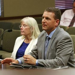 Patty Murphy and Ben Dalton of the Garfield County School District give a presentation during a Garfield County Commission meeting Monday, June 8, 2015, in Panguitch, discussing county economic troubles and declining school enrollment since 1996.