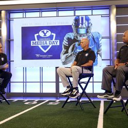Dave McCann talks with BYU assistant head coach coach Ed Lamb and defensive coordinator Ilaisa Tuiaki during BYU football media day at the BYU Broadcasting Building in Provo on Thursday, June 17, 2021.