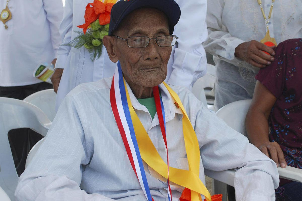 In this April 10, 2012 photo released by the Philippines Veterans Affairs Office, Filipino veteran Alfonso Fabros attends a recognition ceremony at the Capas National Shrine in Tarlac province, northern Philippines. The Philippines said its oldest World W